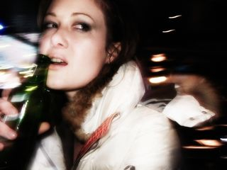 Woman drinking beer motion blur Small